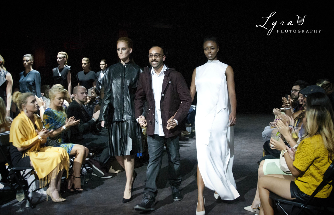 Joseph Singh end-of-show bow with two models