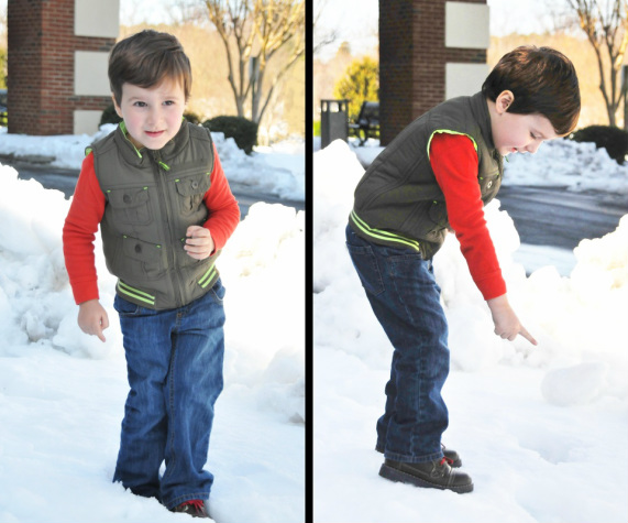 Son playing in snow in Greensboro